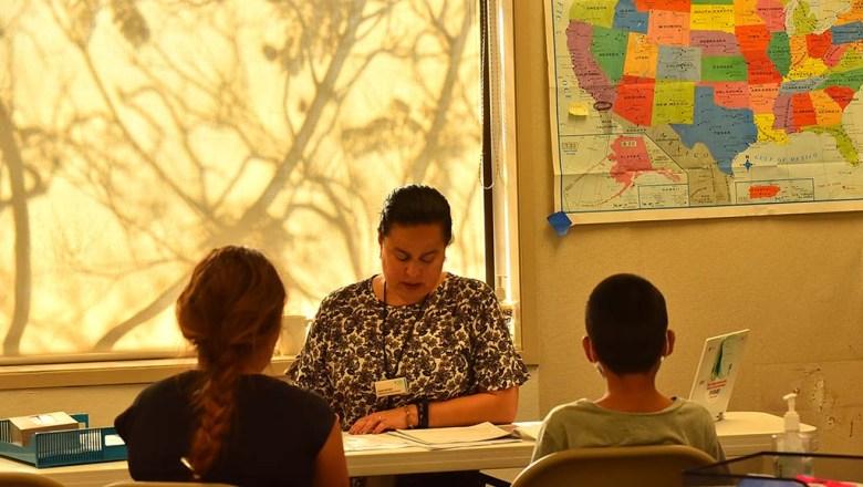 Laura Arroyo of Jewish Family Service meets with family members seeking asylum.