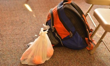 In the new asylum shelter, a backpack and bag of food is readied in the waiting room for people about to be escorted to transportation to asylum seekers' sponsors.
