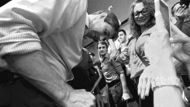 Presidential candidate Beto O'Rourke signs an autograph as he makes his exit from Jacobs Center.
