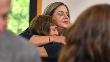 Friends and family comfort each other before the funeral service began at Chabad of Poway synagogue.