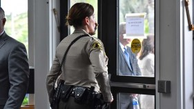 Sheriff's deputies guard the entrance to Chabad of Poway during the funeral service of Lori Kaye.
