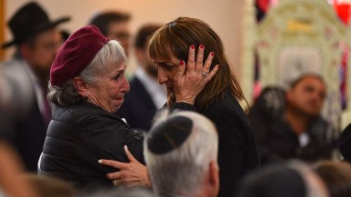 A family friend comforts a speaker who said Lori Kaye was her best friend.
