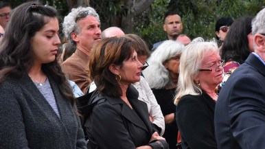 Congregants watched a viewing on a large screen for an overflow crowd to watch.
