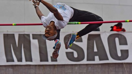 Unattached high jumper Amina Smith clears a height.