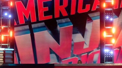 Colleen Barney's head is dwarfed by the ANW logo behind the stage at Universal Studios.