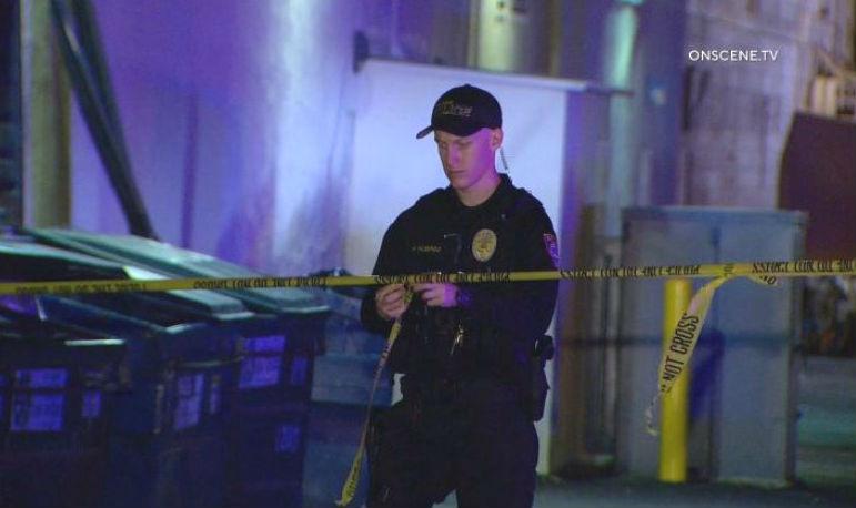 Escondido Police officer strings crime scene tape