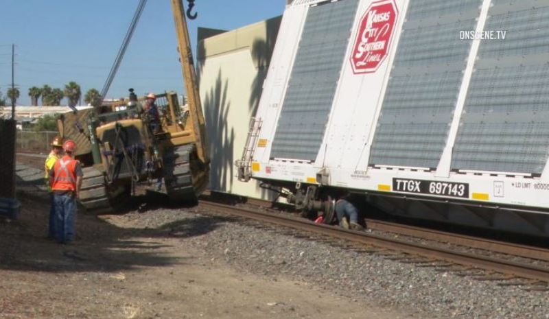 A crew works to right derailed boxcars