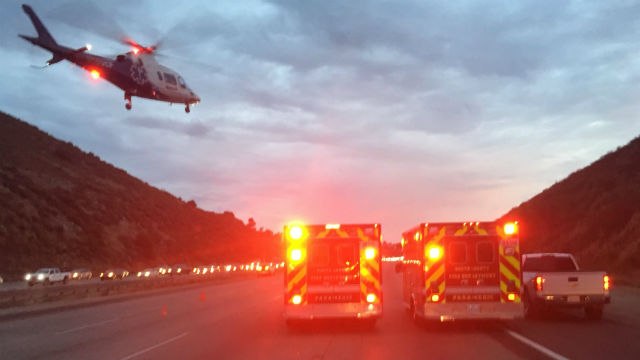 Helicopter and two ambulances at the crash scene