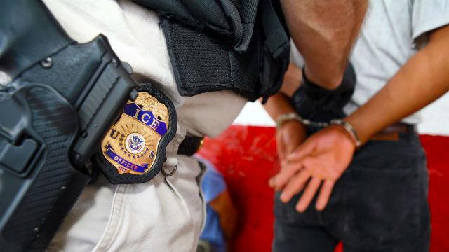 An ICE agent makes an arrest