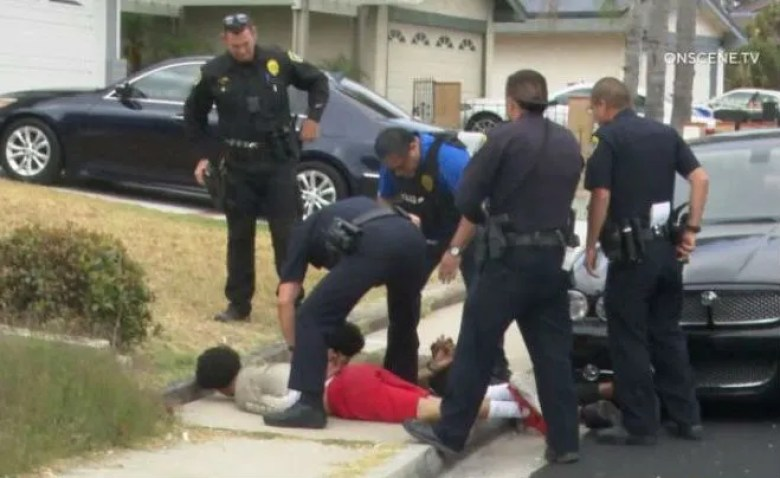 Police make an arrest on July 17, believed to be related to the La Jolla party shooting