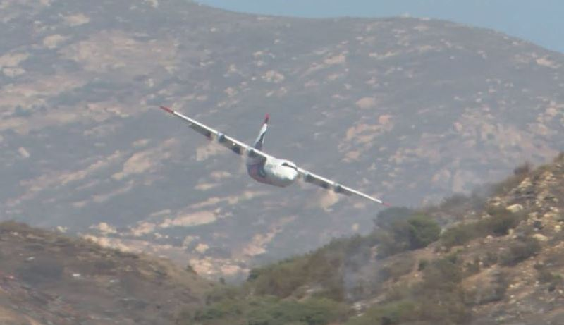 Fire-fighting plane drops retardant