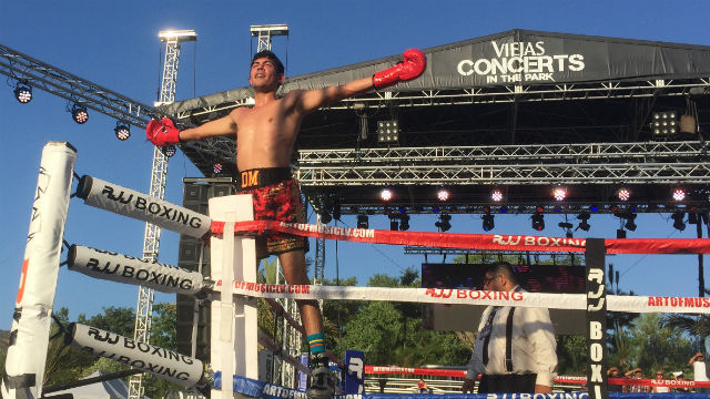 Dilan Miranda celebrates his victory Saturday over Ming Freeman