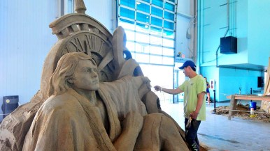 "Jihoon Choi of South Korea works on his art piece, ""The Force"" at the U.S. Sand Sculpting Challenge at the Broadway Pier. Photo by Chris Stone"