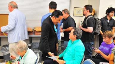 Assemblyman Todd Gloria greets committee members before the endorsement part of the meeting.