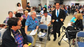 Assemblyman Todd Gloria trots up center aisle at IBEW Union Hall after endorsement results were announced.