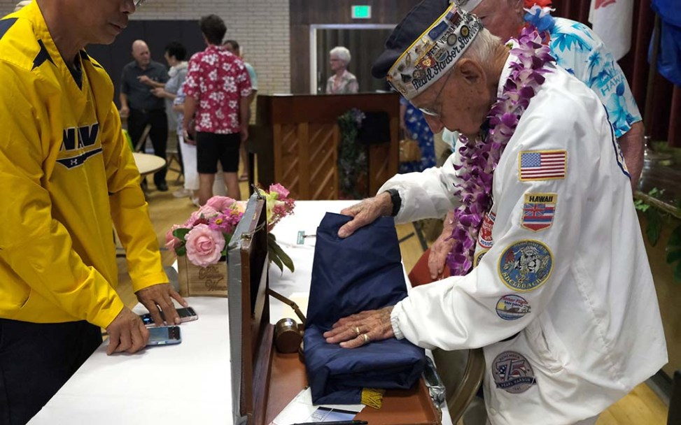 Pearl Harbor survivor Stu Hedley packed up association packs up the chapter's banner for the last time.