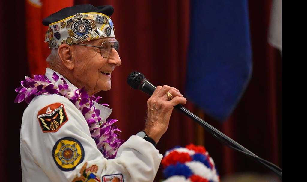 Pearl Harbor Survivor Association president Stu Hedley speaks to about 80 people who attended the last meeting.