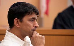 Oscar Stewart, who was a congregant of the synagogue and confronted the suspected shooter John Earnest and chased him out of the building, listened to a question while on the stand during the preliminary hearing.