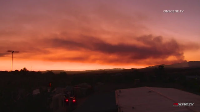 Flames from the Oak Fire light up the sky