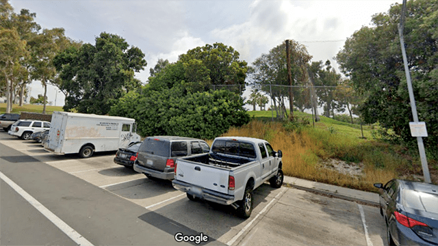 Cars parked outside Colina Park Golf Course.