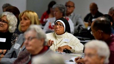 Sister Teresa Gomez listens to speakers at the Pastoral Center conference on climate change.