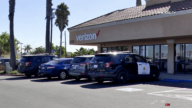 Police inspect Verizon shop on Palm Avenue robbed by a gunman.