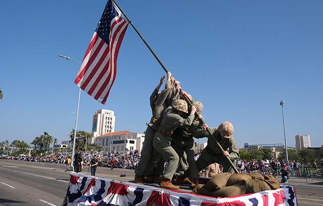 Members of the West Coast Drill Instructors Association reenacting the flag raising at Iwo Jima during WWII.