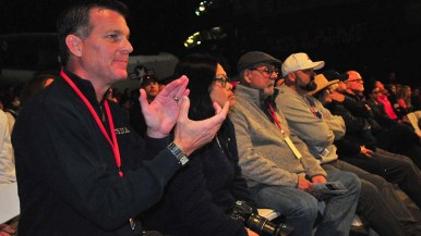 Rob Arnett, next to wife Lorna, applauds Navy wrestlers after flying 3,000 miles to see team his son helps manage.