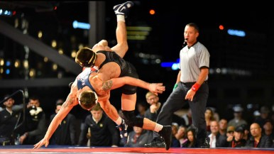 Fresno State's Gary Joint reaches for mat during 133-pound action against Army's Cole Wyman. Joint won 10-2.