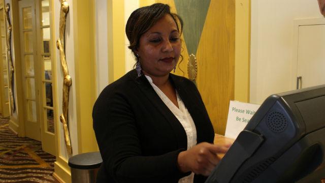 Eden Asfaha works as a cashier