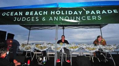 Ocean Beach librarian Matt Beatty (center) and SDTV.com president Mark Yancey (right) were among five parade judges.