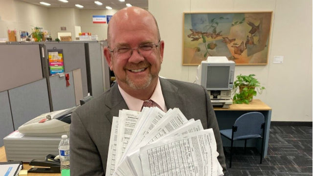 Scott Sherman with election forms