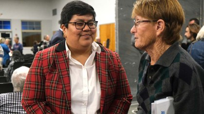 Georgette Gómez visits with an audience member after two-hour debate that addressed issues foreign and domestic.