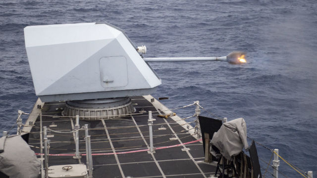 57mm gun aboard USS Montgomery fires