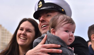 Several USS Abraham Lincoln service members meet their babies for the first time Monday.