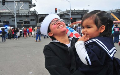 USS Abraham Lincoln sailor Sarah Felix has a laugh with her daughter, Milena Olivas, 18 months, upon arriving in San Diego.