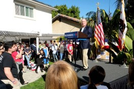 Presidential candidate Mike Bloomberg spoke to about 100 gun safety advocates at a home in Linda Vista.