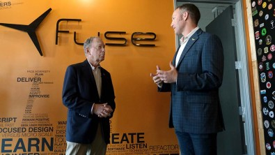 Sumner Lee (right), founder of Fuse, speaks to presidential candidate Mike Bloomberg about his Linda Vista business.