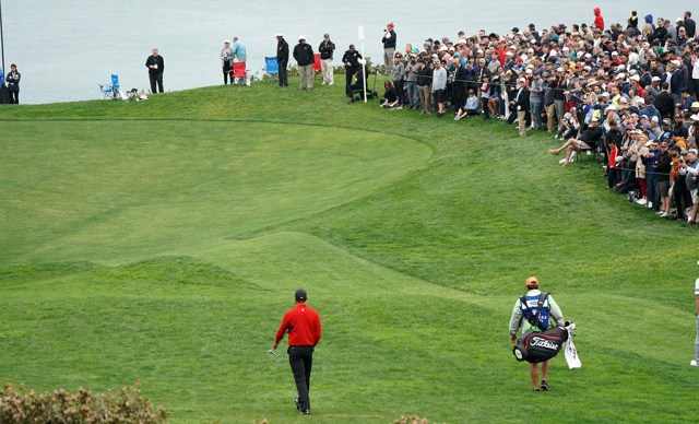 A large crowd gathered on the edge of the 3rd green on the south course of the Farmers Insurance Open.