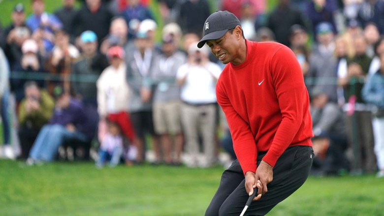 Tiger Woods reacts as his tee shot doesn't go as planned.