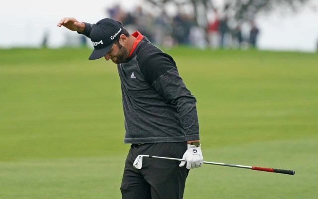 Jon Rahm expresses frustration as a drive doesn't go as planned.