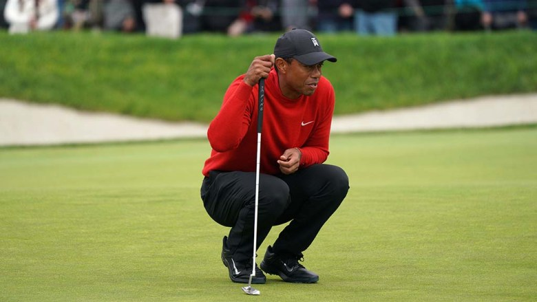 Tiger Woods plans his final putt on the 18th green of the Farmers Insurance Open at Torrey Pines Golf Course.