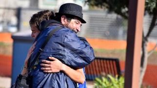 Coach Salvador Velazco-Gil hugs Andres Gonzalez-Aquino after 10K victory in Santee.