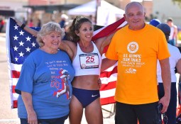 Race winner Robyn Stevens celebrated Olympic Trials title with her parents.
