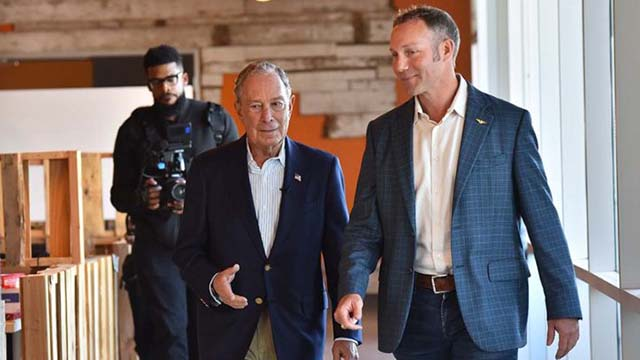 Sumner Lee, founder of San Diego's Fuse Integration, shows presidential candidate Mike Bloomberg his Linda Vista business in a January visit. Lee says he is just over 6 feet.