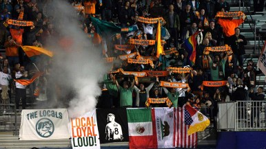 The Locals, an enthusiastic group of fans, cheer their new soccer team.