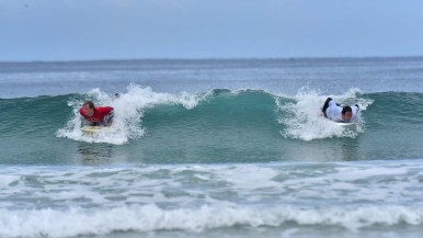 Two para-surfers share the same wave as they compete in the Ampsurf 2020 ISA World Para Surfing Championship at La Shores.