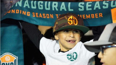 Alexander Moreno, 8, holds up a Loyal scarf as the match was about the begin