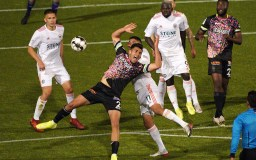 Ramon Martin Del Campo (center) blocks a ball.