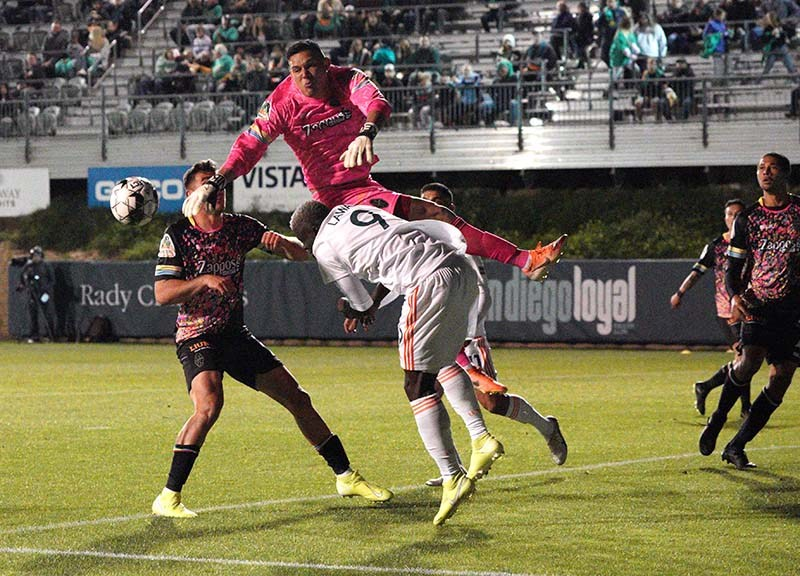 Edward Delgado, goal keeper for the Las Vegas Lights, flips after leaping to block a goal attempt.